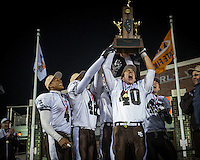 Mt Carmel team captains hoist the 7A State Championship trophy in DeKalb Saturday