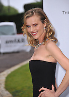 Eva Herzigova  at the 21st annual amfAR Cinema Against AIDS Gala at the Hotel du Cap d'Antibes.<br /> May 22, 2014  Antibes, France<br /> Picture: Paul Smith / Featureflash