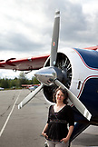 ALASKA, Talkeetna, Sandra Loomis the owner of Talkeetna Air Taxi in front of an otter equiped with skiis to land on Denali