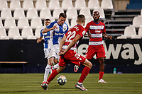 22nd June 2020; Estadio Municipal de Butarque, Madrid, Spain; La Liga Football, Club Deportivo Leganes versus Granada; Javi Eraso (CD Leganes) takes on Duarte of Granada near the box