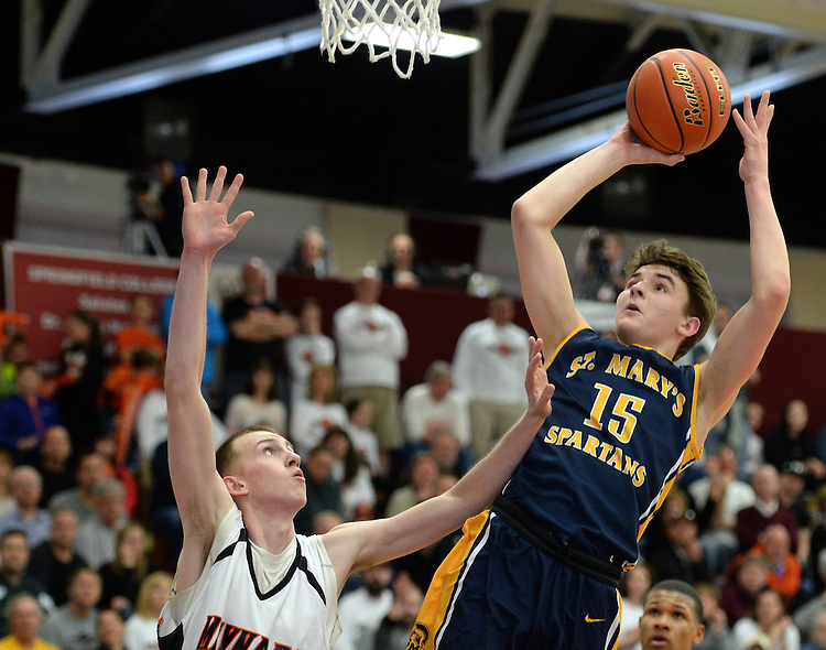 (Springfield, MA, 03/19/16) St. Mary's Matthew Cross, right, shoots the ball over Maynard's Jared Buckley during the fourth quarter of the Boys Division 4 state basketball final at Springfield College on Saturday, March 19, 2016. Staff photo by Christopher Evans