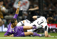 Calcio, Champions League: finale Juventus vs Real Madrid. Cardiff, Millennium Stadium, 3 giugno 2017.<br /> Real Madrid's Cristiano Ronaldo (l) in action with Juventu's Giorgio Chiellini (r) during the Champions League final match between Juventus and Real Madrid at Cardiff's Millennium Stadium, Wales, June 3, 2017. Real Madrid won 4-1.<br /> UPDATE IMAGES PRESS/Isabella Bonotto