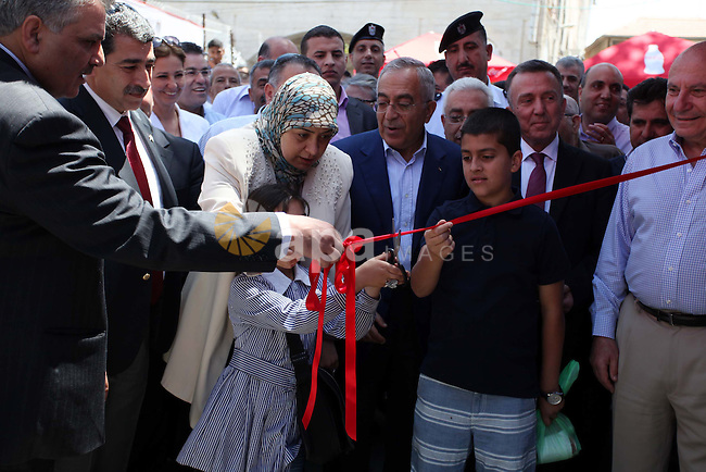 Former Palestinian Prime Minister Salam Fayyad opens popular market in the West Bank city of Ramallah city on June 4, 2013. Photo by Issam Rimawi