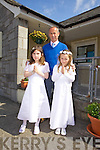 Pictured with their teacher/principal Mike Lynch from St John's Parochial School, Ashe St., Tralee were pupils  Jessica Harrington and Siofra O'Carroll who made their First Holy Communion in the Immaculate Conception Church, Rathass on Saturday.
