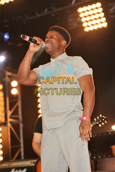 CHASE & STATUS - Tempa T.Performing live at Radio 1's Big Weekend, Carlisle, England, UK,.May 14th 2011..festival music on stage concert gig half length singing grey gray blue top singing .CAP/MAR.© Martin Harris/Capital Pictures.