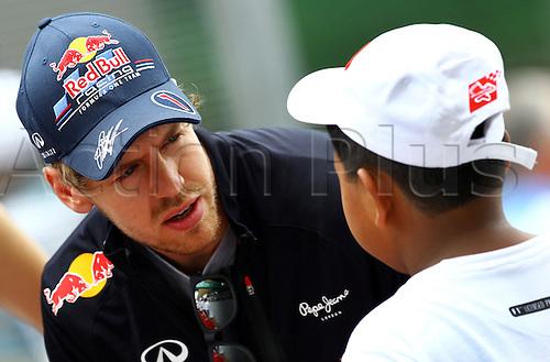 25.03.2012. Kuala Lumpur, Malaysia.  German Formula One driver Sebastian Vettel of Red Bull seen during the driver's parade before the Formula One Grand Prix of Malaysia at the Sepang circuit, outside Kuala Lumpur, Malaysia, 25 March 2012.