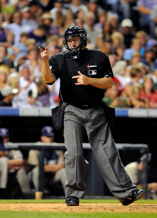 10 JULY 2010: Home plate umpire Gary Cederstrom calls a strike during a regular season Major League Baseball game between the Colorado Rockies and the San Diego Padres at Coors Field in Denver, Colorado. The Rockies beat the Padres 4-2.  *****For Editorial Use Only*****
