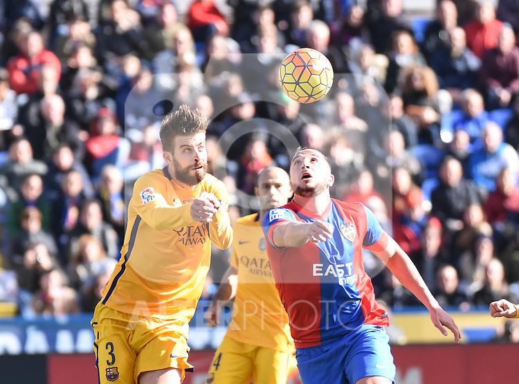 Levante's  Ghilas   and FC Barcelona's Gerard Pique  during La Liga match. February 7, 2016. (ALTERPHOTOS/Javier Comos)