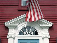 "Architectural detail of historic house with American flag. Historic plaque reads: """"Nathan Seamans House, c. 1792."""" 14 Arnold Street, Fox Point section, Providence, Rhode Island."