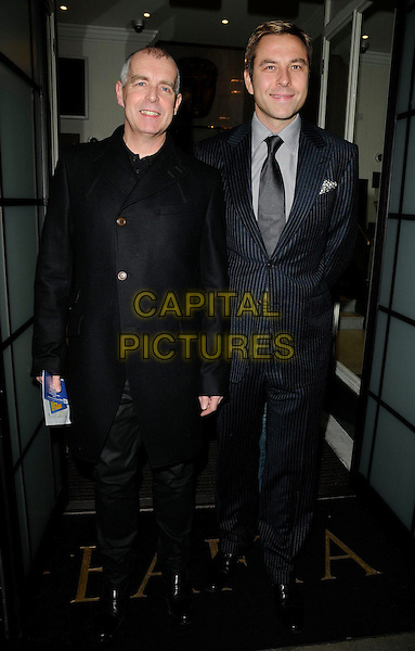 NEIL TENNANT & DAVID WALLIAMS.Charity Screening of 'Nowhere Boy' held at BAFTA Piccadilly, London, England. .November 26th, 2009 .full length blue navy black suit jacket coat.CAP/CAN.©Can Nguyen/Capital Pictures.
