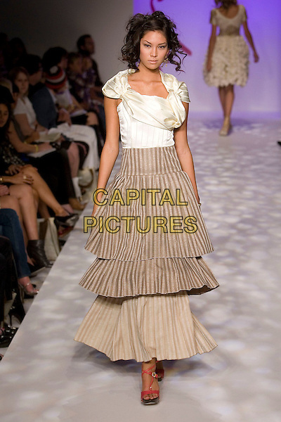 MODEL.Mercedes-Benz Spring 2007 L.A. Fashion Week - Yana K - Runway held at Smashbox Studios, Culver City, California, USA, 19 October 2006..full length catwalk fashion striped brown dress skirt layered long white cream top.Ref: ADM/ZL.www.capitalpictures.com.sales@capitalpictures.com.©Zach Lipp/AdMedia/Capital Pictures.