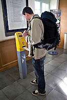 Young person validating ticket on SNCF rail network France..©shoutpictures.com.john@shoutpictures.com