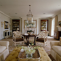 The order and symmetry of the 18th century are obvious influences in the meticulous arrangement of the living room