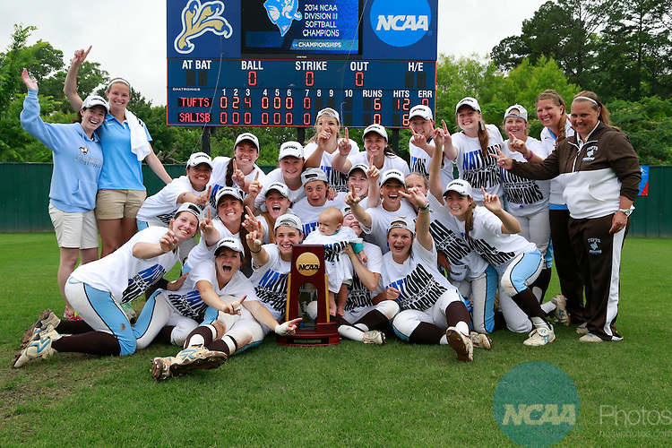 27 MAY 2014:  Tufts University players and coaches pose with the NCAA Championship trophy after the game against Salisbury University for the Division III Women's Softball Championship held at the UT Tyler Ballpark in Tyler, TX. Tufts defeated Salisbury 6-0 for the national title. Tim Heitman/NCAA Photos
