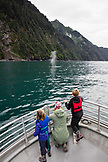 USA, Alaska, Seward, passengers exploring Resurrection Bay on a boat the way to Holgate Glacier, Watching a Humpback Whale Spout