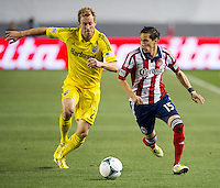 CARSON, CA - March 2, 2013: Columbus Tyson Wahl (2) and Chivas midfielder Eric Avila (15) during the Chivas USA vs Columbus Crew match at the Home Depot Center in Carson, California. Final score, Chivas USA 0, Columbus Crew 3.