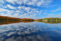Clouds reflected in Horseshoe Lake. Autumn<br /> Near Parry Sound<br /> Ontario<br /> Canada