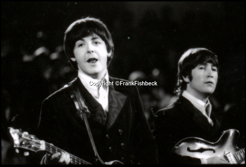 BNPS.co.uk (01202 558833)<br /> Pic: FrankFischbeck/Spink/BNPS<br /> <br /> Lennon and McCartney on stage at the Circus Krone Bau in Munich - 2 months later they quit the stage for good.<br /> <br /> Unseen photos of the fab four touring Germany in 1966 are being sold showing the group just before they ditched the suits, gave up touring and embraced the flower power revolution.<br /> <br /> The candid snaps were taken by enterprising photographer Frank Fishbeck in Munich and Essen in June 1966 after he had managed to <br /> follow them into their Munich hotel and they invited him to their concert.