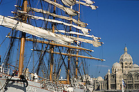Russian Sedov Sailing Boat at a wharf with Marseille Cathedral in the background, Marseille, France.