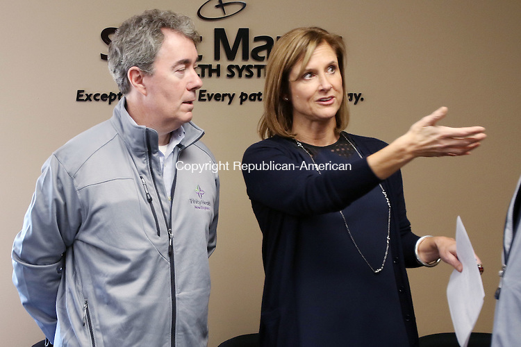 TORRINGTON CT. 14 November 2016-110816SV05-Kristen Jacoby, President/Chief Professional Officer of United Way of Greater Waterbury, right, talks with Chris Dadlez, President and CEO of Trinity Health &ndash; New England at the United Way offices in Waterbury Monday.<br /> Steven Valenti Republican-American