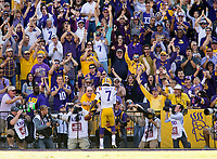 NWA Democrat-Gazette/BEN GOFF @NWABENGOFF<br /> DJ Chark, LSU wide receiver, runs to the stands after scoring against Arkansas in the fourth quarter Saturday, Nov. 11, 2017 at Tiger Stadium in Baton Rouge, La.