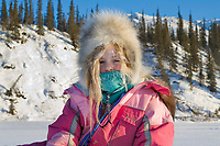 Julia Hicker in winter snow suit on the Koyukuk River, Wiseman, Alaska
