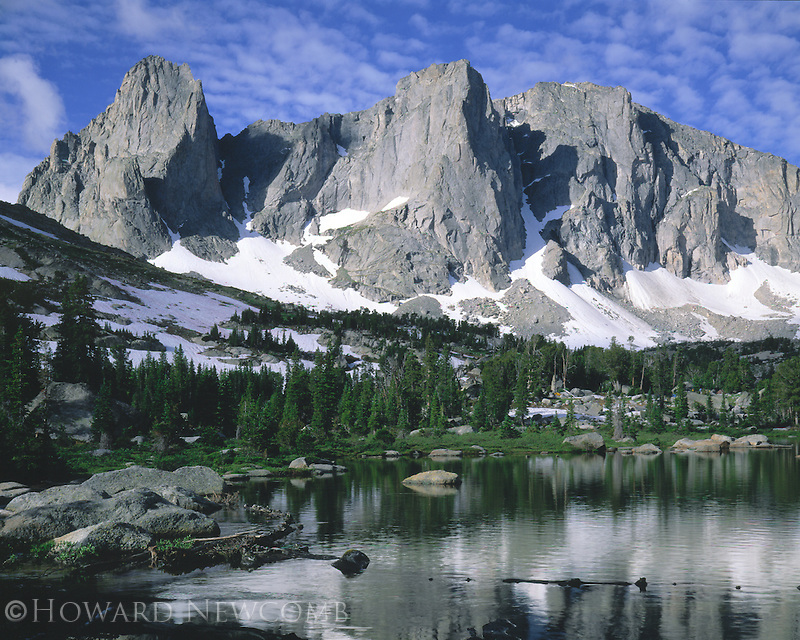 War Bonnet Peaks rise dramatically above Lonesome Lake in the Wind River Range, Wyoming.