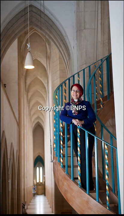 BNPS.co.uk (01202 558833)<br /> Pic: PhilYeomans/BNPS<br /> <br /> Dean Dianna Gwilliams in the stunning interior of Guildford Catherdal.<br /> <br /> Bad omens..<br /> <br /> One of Britains great cathedral's could be closed down if an emergency appeal for &pound;1.3 million is not successful by the end of August.<br /> <br /> Historic Guildford cathedral, where cult horror film The Omen was filmed, is facing closure because its ceiling is laced with asbestos.<br /> <br /> The 10,000sq ft ceiling of Guildford Cathedral was sprayed with a special acoustic plaster made from the deadly mineral in a bid to improve the sound quality when it was built in the 1960s.<br /> <br /> Fifty years on the ceiling has started to crumble forcing church bosses to launch an appeal to raise &pound;7 million pounds to pay for its restoration.<br /> <br /> They say that if the money can't be raised they will have no choice but to close its doors for good - the first British cathedral ever to do so.<br /> <br /> To add further pressure to the campaign, they have to raise 1.3 million pounds by the end of August in order to qualify for a Heritage Lottery Fund.<br /> <br /> More than 200,000 people paid two shillings and sixpence - the equivalent of 12.5 pence today - to buy a brick when the price of building materials shot up after World War II.