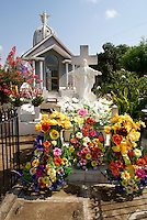 Grave decorated with flowers in the town cemetery, El Quelite near  Mazatlan, Sinaloa, Mexico