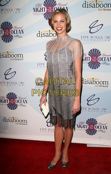"BROOKE BURNS .Life Rolls On Foundation's ""Night By the Ocean"" Benefit held at  Hollywood & Highland Grand Ballroom, Hollywood, California, USA, .12 October 2008..full length silver twenties style dress 20's beaded layered .CAP/ADM/KB.©Kevan Brooks/Admedia/Capital PIctures"