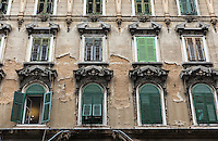 Building facade with shuttered windows, Rijeka, Croatia