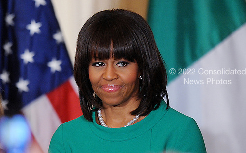First lady Michelle Obama looks on during a reception in the East Room on March 19, 2013 in Washington, DC. <br /> Credit: Olivier Douliery / Pool via CNP