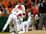 15 September 2007: Washington Nationals first baseman Dmitri Young (21) is helped up by Manager Manny Acta after Young was knocked down by a line drive during a game against the Atlanta Braves at Robert F. Kennedy Memorial Stadium in Washington, DC. The Nationals defeated the Braves 7-4 in the second game of their 3-game series...Mandatory Photo Credit: Ed Wolfstein Photo