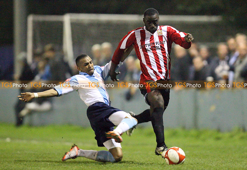 Tambeson Eyong of Hornchurch is challenged by Nicholas Muir of Brentwood - Brentwood Town vs AFC Hornchurch - FA Cup 2nd Qualifying Round Replay at the Brentwood Centre - 28/09/10 - MANDATORY CREDIT: Gavin Ellis/TGSPHOTO - Self billing applies where appropriate - Tel: 0845 094 6026