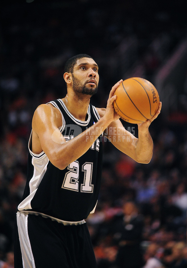Dec. 15, 2009; Phoenix, AZ, USA; San Antonio Spurs forward (21) Tim Duncan shoots a free throw against the Phoenix Suns at the US Airways Center. The Suns defeated the Spurs 116-104. Mandatory Credit: Mark J. Rebilas-