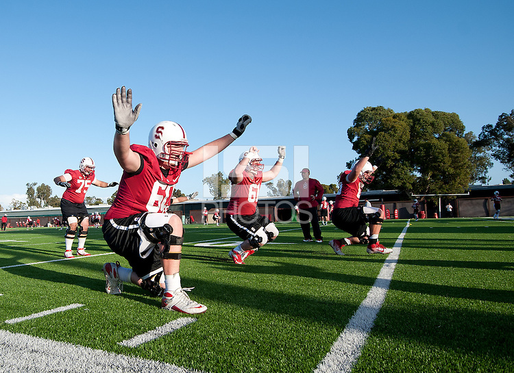 Stanford, Ca - February 27, 2012: The Stanford Cardinal works out during their first practice of Spring 2012.