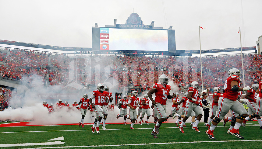 Ohio State Buckeyes run onto the field for the start of their game against Northern Illinois Huskies at Ohio Stadium on September 19, 2015.  (Dispatch photo by Kyle Robertson)