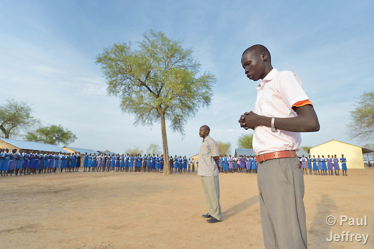 A student leads fellow students in prayer at the beginning of class in the Caritas-supported St. Daniel Comboni School in Agok, South Sudan, where tens of thousands of residents of Abyei, a contested region along the border between Sudan and South Sudan, remain displaced. Under a 2005 peace agreement, Abyei was supposed to have a referendum to decide which country it would join, but the two countries have yet to agree on who can vote. In 2011, militias aligned with Khartoum drove out most of Abyei's Dinka Ngok residents, pushing them across a river into the town of Agok. More than 40,000 Dinka Ngok have since returned to Abyei with support from Caritas South Sudan, which has drilled wells, built houses, opened clinics and provided seeds and tools for the returnees. Yet continuing insecurity means a greater number remain in Agok, where they remain dependant on Caritas and other organizations for food and other support.