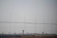 Daytime landscape view from a train of a matrix of communication towers near Dàtóng Shì Chéng Qū in Shānxī Province, China  © LAN