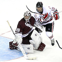 Colgate goalie Eric Mihalik and Nebraska-Omaha's Alex Simonson. (Photo by Michelle Bishop)
