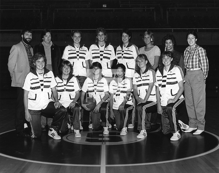 1984: Womens Basketball Team.<br /><br />(Kneeling from left to right): Kim Mercer, Erica Mueser, Charli Turner, Virginia Sourlis, Judy Griffith, and Karen Goedewaagen.  (Standing from left to right): Asst. Coach Mike Kehoe, Head Coach Dotty McCrea, Kami Anderson, Barbara Hunt, Mary Bradach, Sue Sebolt, Manager Yvette Lee, and Asst. Coach Eileen Roche.