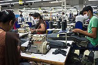 Line workers sew garments together into finished products at the Pratibha vertically integrated garment unit in Indore, Madhya Pradesh, India on 11 November 2014. Photo by Suzanne Lee for Fairtrade