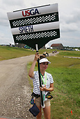 June 14th 2017, Erin, Wisconsin, USA; Volunteer Andrea O'Bryon gets an autographed ball from Jordan Spieth after carrying his sign during the practice round for the 117th US Open on June 14, 2017 at Erin Hills in Erin, Wisconsin