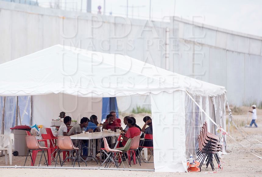 Migranti nella tendopoli allestita presso la stazione Tiburtina a Roma, 16 giugno 2015.<br /> Migrants in the tent camp set up near the Tiburtina railway station in Rome, 15 June 2015. Italy is facing a huge flow of migrants brought to Sicily after rescue at sea, many of whom are trying to join their relatives in northern Europe. <br /> UPDATE IMAGES PRESS/Riccardo De Luca