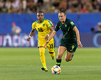GRENOBLE, FRANCE - JUNE 18: Caitlin Foord #9 of the Australian National Team battle for the ball as Trudi Carter #18 of the Jamaican National Team closes during a game between Jamaica and Australia at Stade des Alpes on June 18, 2019 in Grenoble, France.