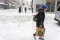 New York, NY 23 Jnuary 2016 Winter Storm Jonas hit New York City. New York Governor Andrew Cuomo and NYC Mayor Bill de Blasio put a travel ban into effect, banning non-emergency vehicles from the streets. Subway and bus service was suspended for the duration of the storm. As of 7pm there were over 300 car accidents and three people had died shoveling snow. ©Stacy Walsh Rosenstock/Alamy Live News