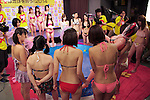"""Japanese adult movie actresses play the game during the 24 hour telethon event with the aim of raising money for a Stop AIDS charity on August 31, 2014 in Tokyo, Japan. The adult movie stars allowed fans to feel their breasts in return for a donation to the AIDS charity. The 12th annual 24 hour TV event """"Eroticism Saves the Earth Telethon"""" is organized by Sky Perfect Tv Adult Chanel with motto """"Social contribution while enjoying the erotic"""". Fans are given the chance to interact with some of the channels leading actresses in the live broadcast event that runs from Saturday afternoon through until Sunday 20:00 hrs. The organizers expect to attract around 2000 fans raising JPY 2 million (US$20, 000) over the weekend. (Photo by Rodrigo Reyes Marin/AFLO)"""