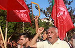 Palestinian supporters of the Popular Front for the Liberation of Palestine (PFLP) take part in a protest demanding to lift the sanctions on Gaza Strip, in Gaza city on July 18, 2018. Photo by  Abed Abu Ryash 