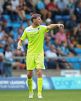 Chris Porter of Colchester United gives instructions during the Sky Bet League 2 match between Wycombe Wanderers and Colchester United at Adams Park, High Wycombe, England on 27 August 2016. Photo by Andy Rowland.