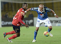 BOGOTÁ -COLOMBIA, 11-10-2014. Juan Esteban Ortiz (Der) jugador de Millonarios disputa el balón con Yeferson Mena (Izq) jugador de Independiente Medellín durante partido por la fecha 14 de la Liga Postobón II 2014 jugado en el estadio Nemesio Camacho el Campín de la ciudad de Bogotá./ Juan Esteban Ortiz (R) player of Millonarios fights for the ball with Yeferson Mena (L) player of Independiente Medellin during the match for the 14th date of the Postobon League II 2014 played at Nemesio Camacho El Campin stadium in Bogotá city. Photo: VizzorImage/ Gabriel Aponte / Staff